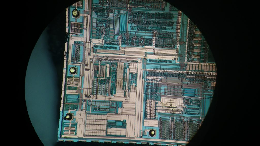 A picture of the die using reflected differential interference contrast (DIC). The colors appear different (mostly blue and gold) but the contrast between the elements of the chip are greatly enhanced.